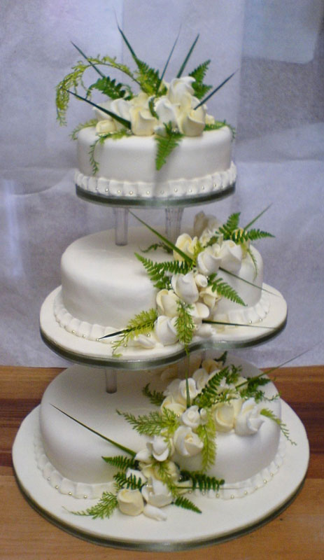 Lethas Blog Lovely Three Tier White Wedding Cake With Sugar Hydrangea Flowers And Green